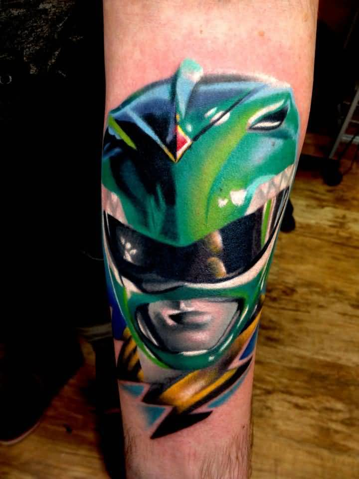 Arm Decorated With Green Mask Tattoo Design By Levi Barnett