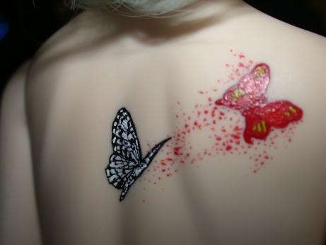 Artifical Temporary Flying Monarch Butterfly Tattoo On Girl Back