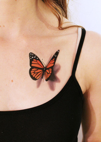 Artifical Temporary Monarch Butterfly Tattoo On Girl Chest