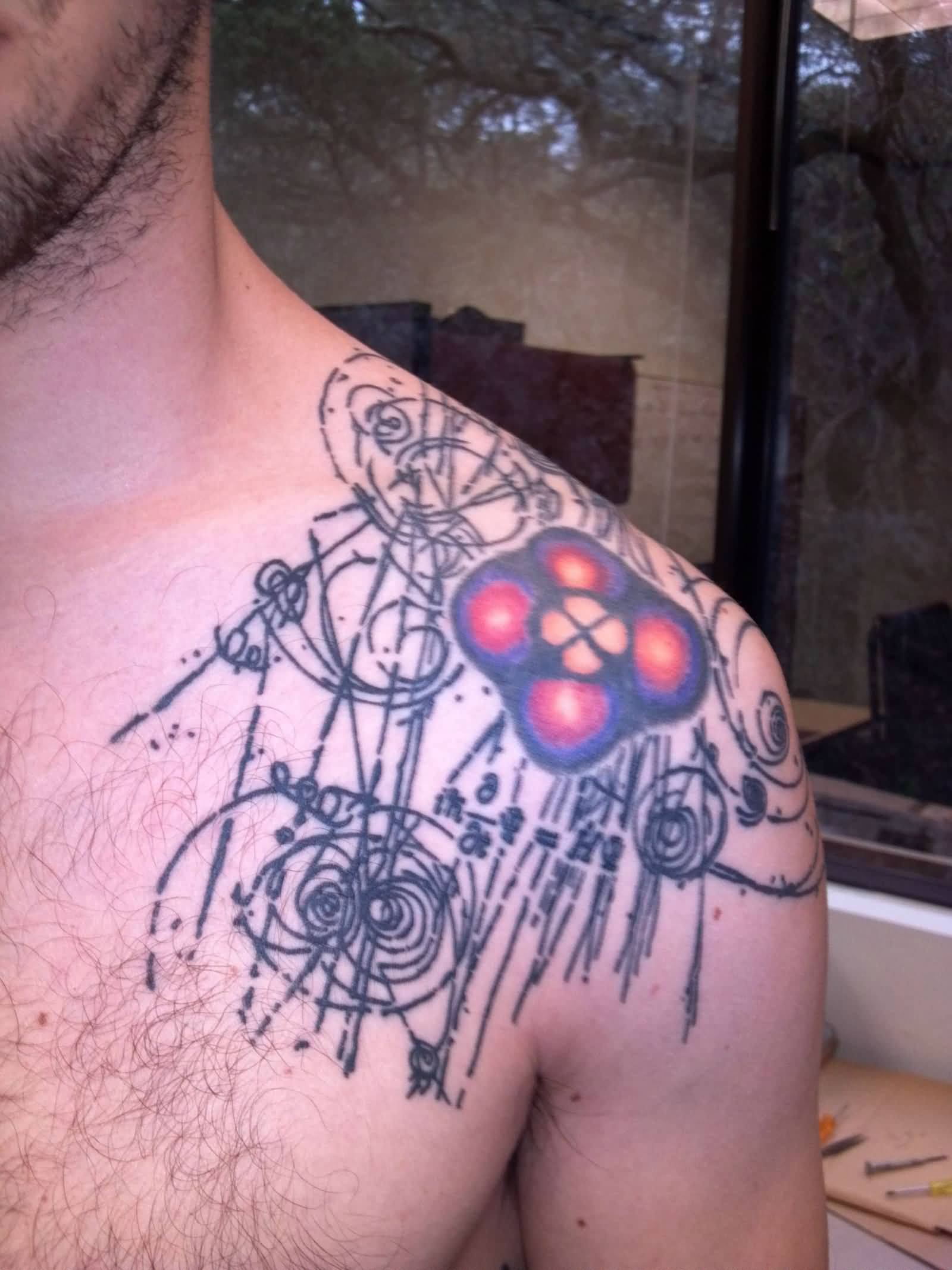 Atom Of Hydrogen Physics Tattoo On Men Shoulder