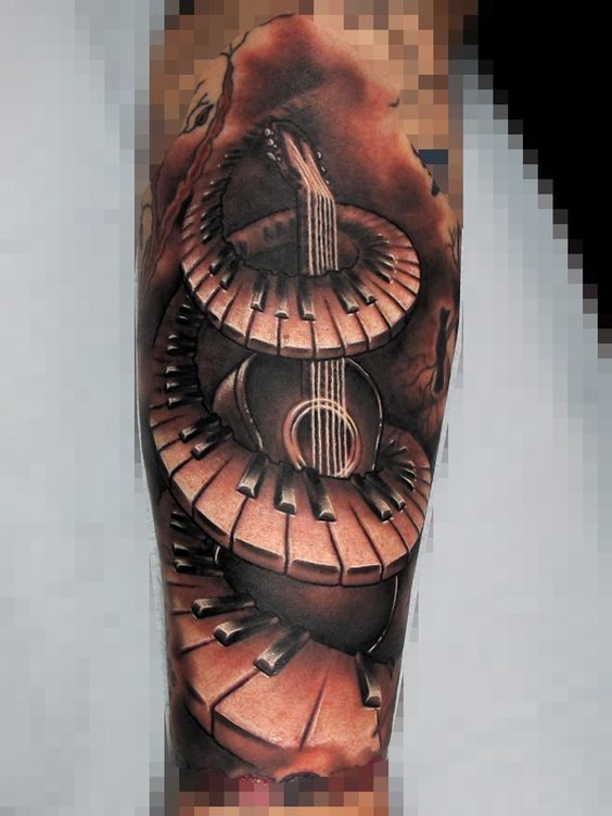 Awesome And Nice Lower Sleeve Guitar Aroubd Piano Keys Tattoo