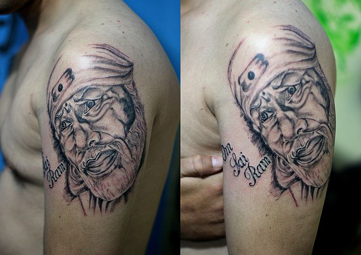 Awesome And Nice Sai Baba Face Tattoo On Shoulder