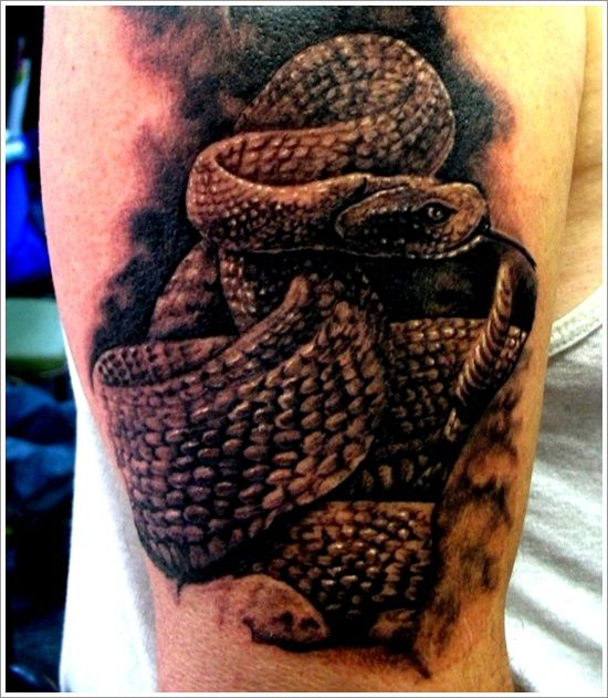 Awesome Angry Reptile Snake Coil Tattoo