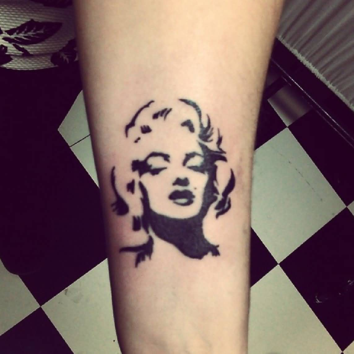 Awesome Black Ink Portrait Face Of Marilyn Monroe Tattoo