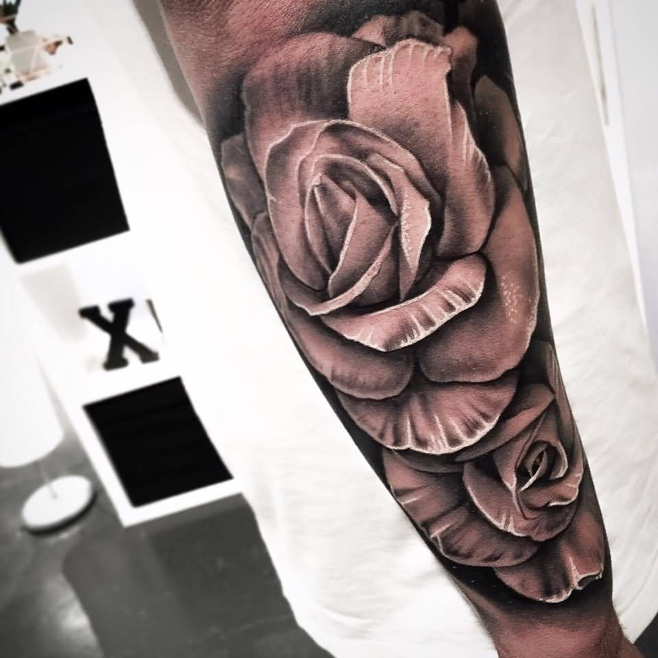 Beautiful Grey Ink Nice Rose Tattoo On Lower Arm Made By Levi Barnett