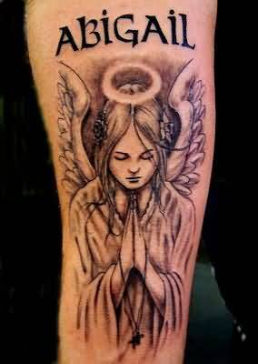 Black Ink Abigail Trxt With Nice Praying Angel Tattoo