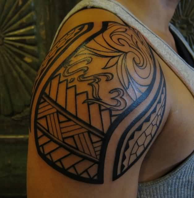 Black Ink Amazing Filipino Tribal Tattoo On Shoulder