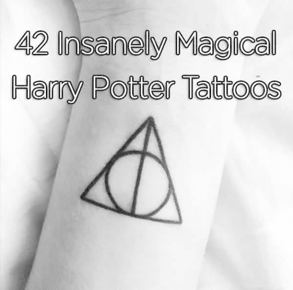 Black Ink Hallows Tattoo On Wrist