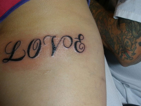 Black Ink Love Forearm Tattoo