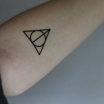 Black Ink Nice Circle Hallows Tattoo
