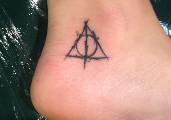 Black Ink Nice Deathly Hallows Tattoo On Ankle