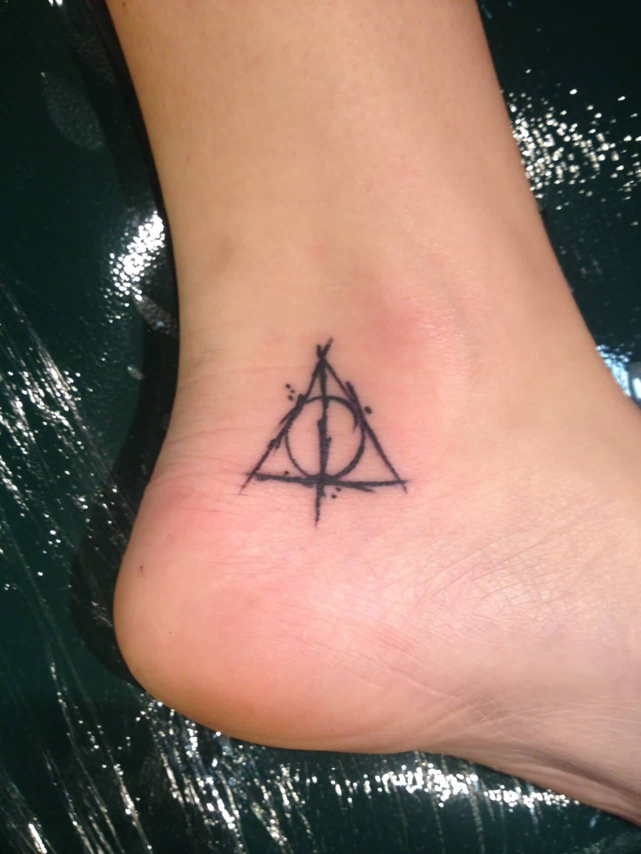 Black Ink Nice Hallows Tattoo On Ankle (2)