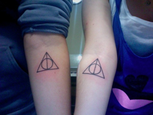Black Ink Nice Hallows Tattoo On Forearm Of Girl
