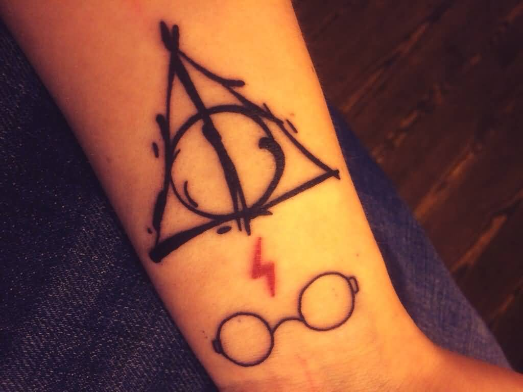 Black Ink Nice Hallows Tattoo On Wrist With Thunder Sign