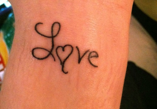 Black Ink Nice Love Heart Text Tattoo