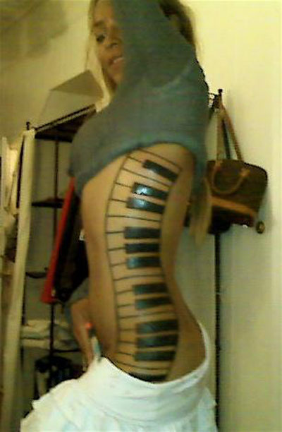 Black Ink Piano Keys Tattoo Design For Girl Side Rib
