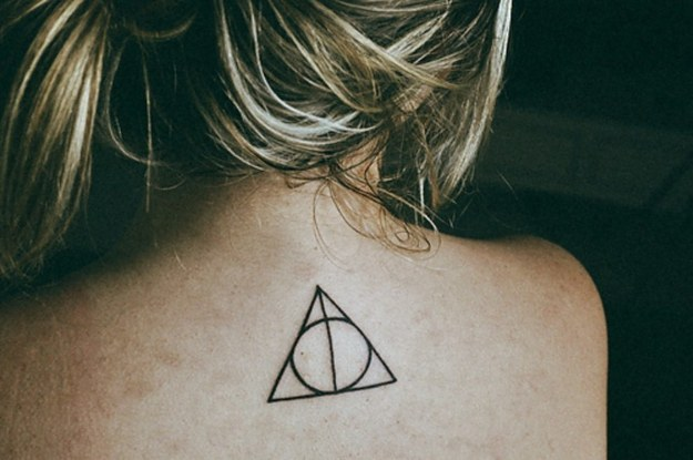 Black Ink Simple Hallows Tattoo On Upper Back