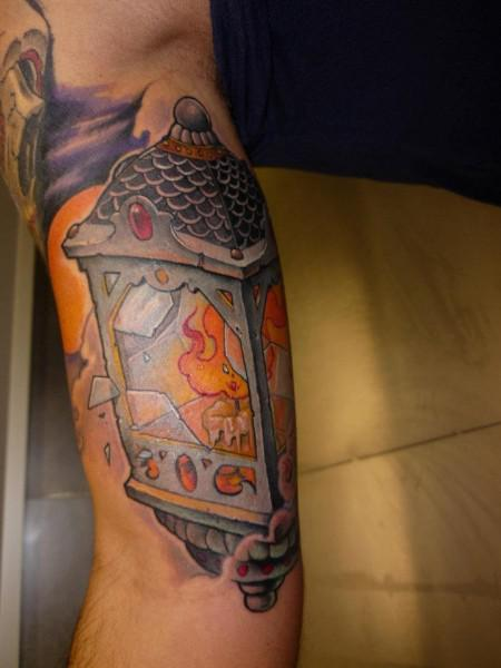 Broken Lantern Tattoo On Bicep
