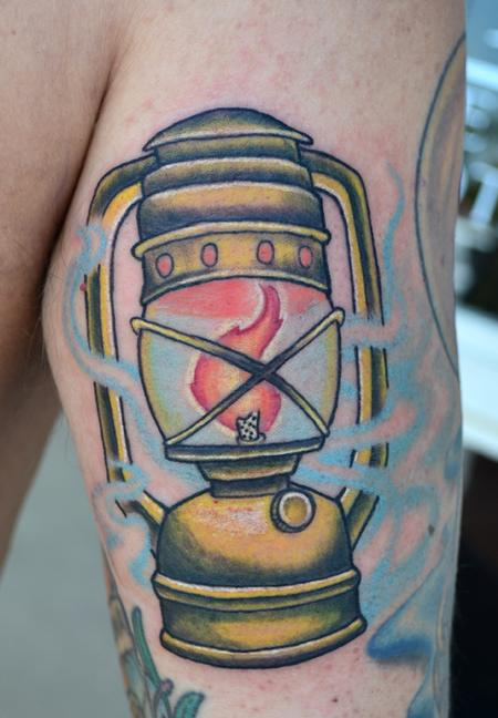 Burning Flame Shih Lantern Tattoo On Leg