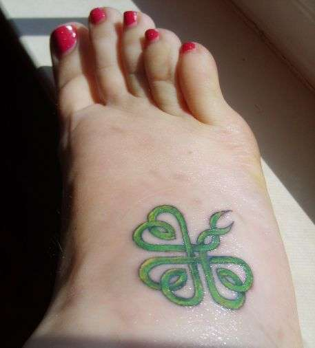 Celtic Green Ink Nice Shamrock Tattoo Design On Girl Foot