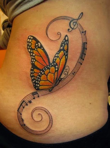 Classy Monarch Butterfly On Music Notes Tattoo