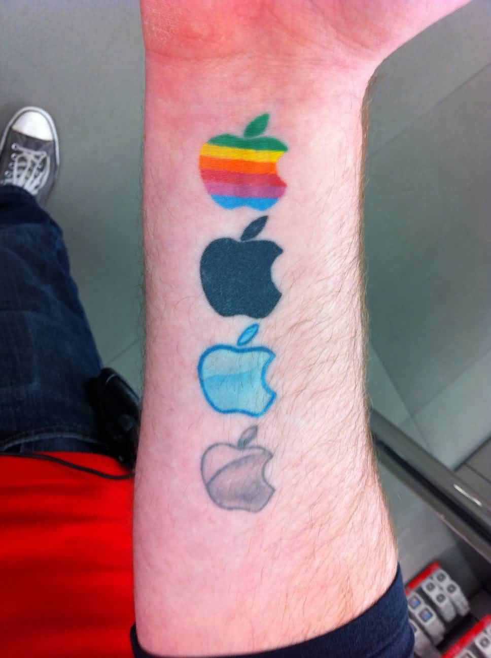 Colorful Apple Logo Tattoo Design On Men Forearm