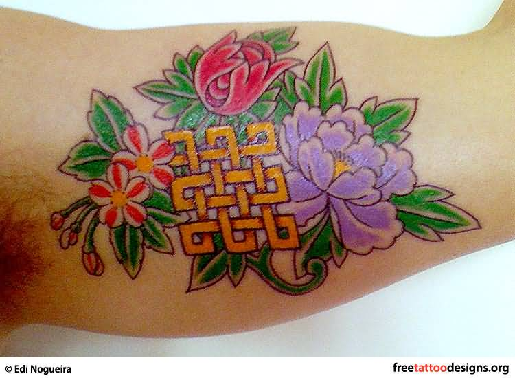 Colorful Flowers And Nice Yellow Ink Endless Knot Tattoo On Bicep