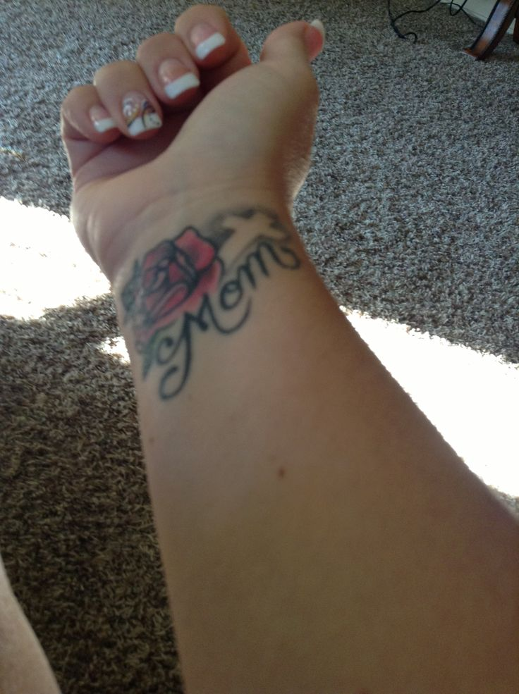Cross Rose Flower Mom Text Tattoo On Girl Wrist