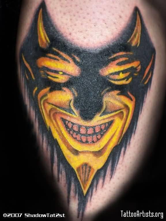 Dark Golden Ink Smiling Mask Of Satan Tattoo