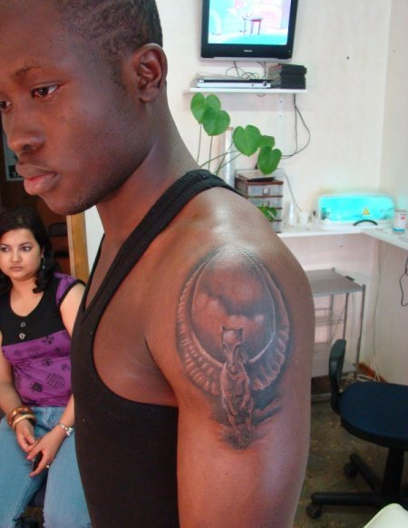 Dark Men Show Flying Nice Pegasus Tattoo On Shoulder