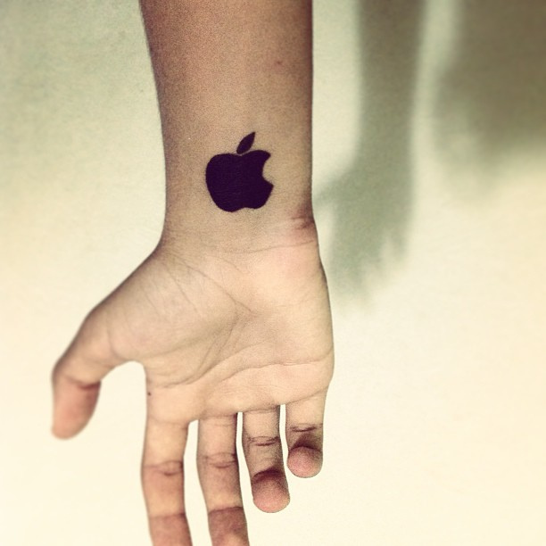 Dark Shaded Nice Apple Logo Tattoo Design On Wrist