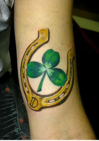 Dark Yellow Ink Horseshoe With Three Leafs Shamrock Tattoo