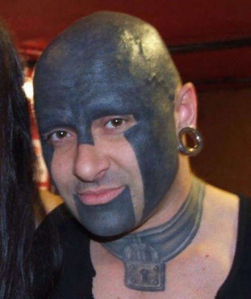 Extreme Helmet Tattoo On Men Face