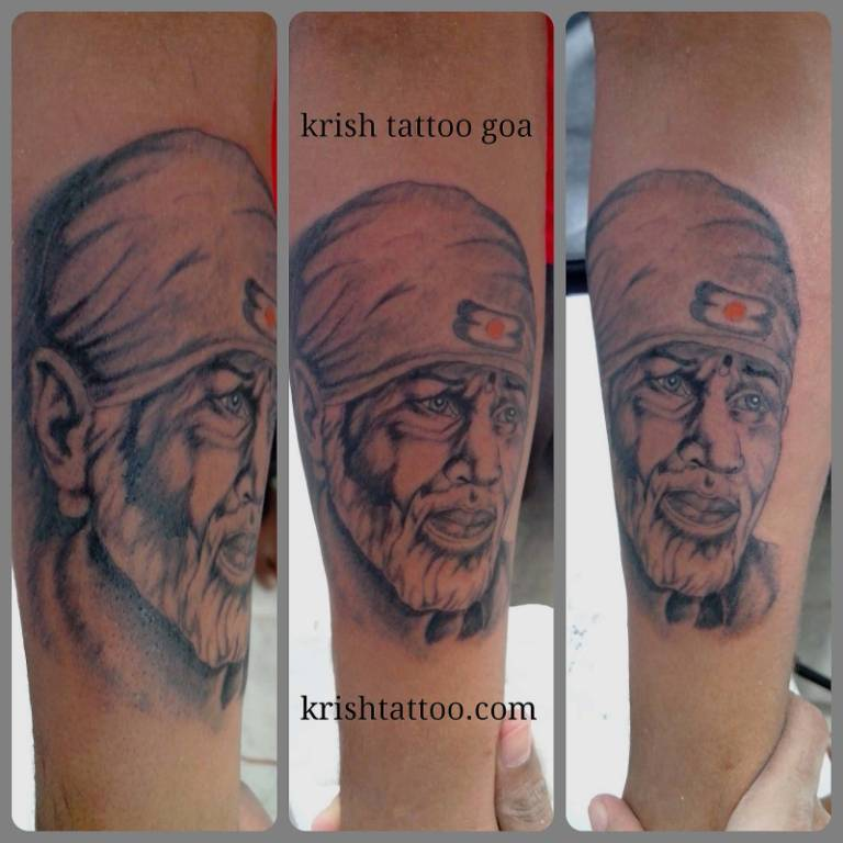 Famous And Nice Sai Baba Face Tattoo Design