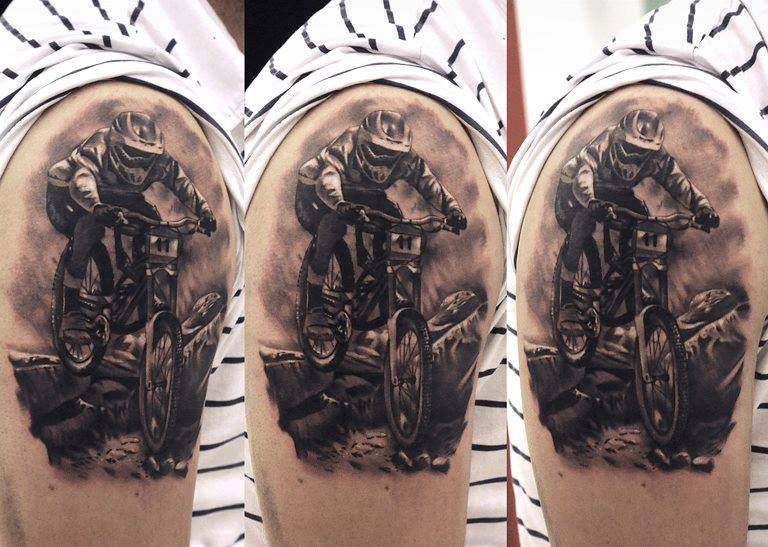 Famous Sportsman Riding On 3d Realistic Bicycle Tattoo Idea On Shoulder