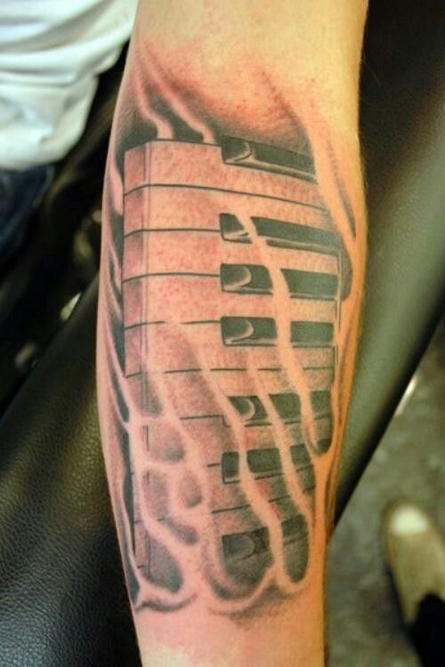 Fantastic And Amazing Piano Keys Tattoo Design Idea