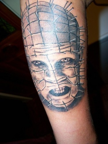 Fantastic And Angry Scary Pinhead Tattoo Design