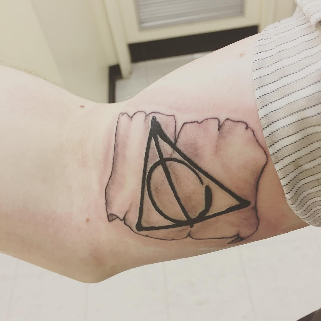 Fantastic And Nice Hallows Tattoo On Bicep