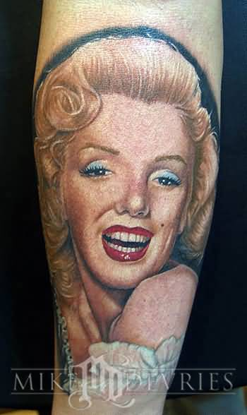 Fantastic And Nice Looking Marilyn Monroe Portrait Face Tattoo