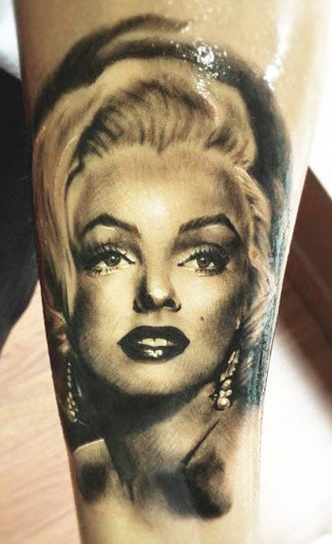 Fantastic And Nice Marilyn Monroe Face Tattoo Design Idea On Forearm