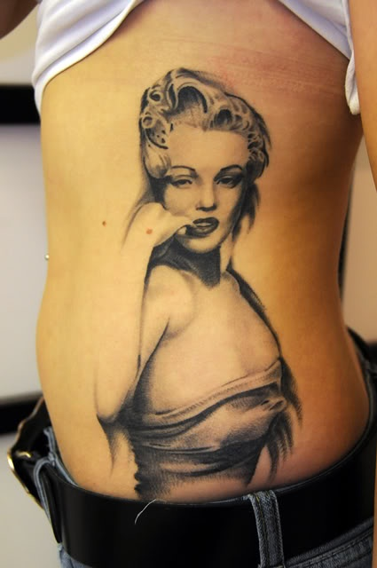 Fantastic And Nice Marilyn Monroe Tattoo Design Idea On Girl Rib Side