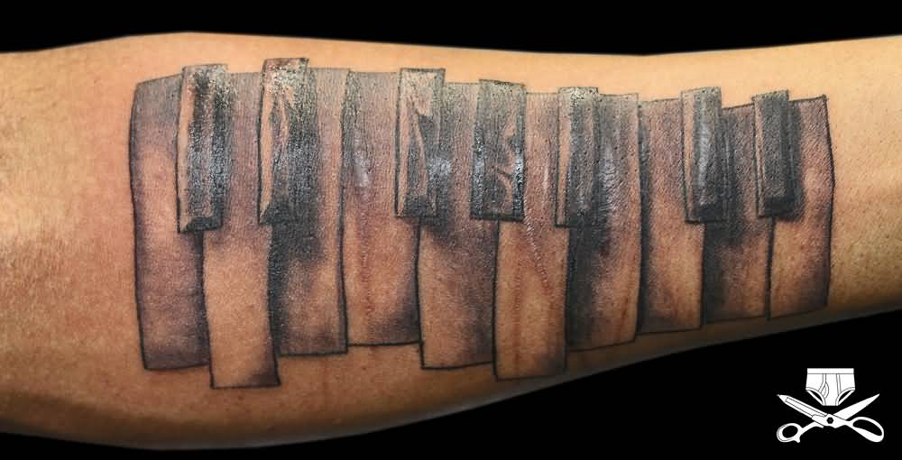 Fantastic And Nice Piano Keys Tattoo Design Idea On Forearm