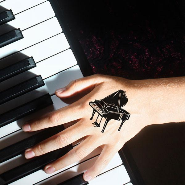 Fantastic Black Ink Nice Grand Piano Tattoo Design On Hand