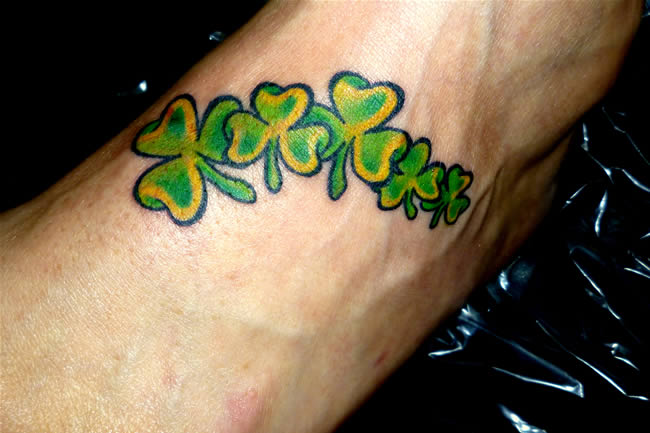 Fantastic Green Ink Amazing Shamrock Tattoo On Foot