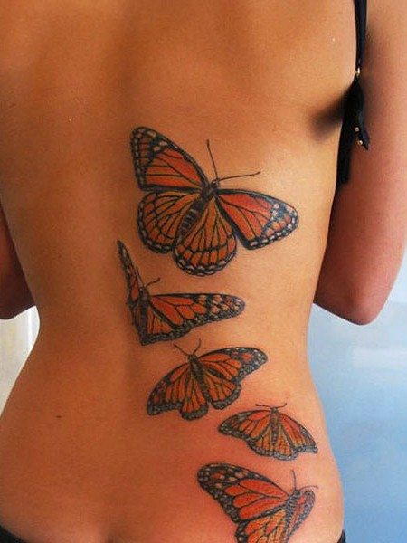 Flying Monarch Butterfly Family Tattoo On Girl Back