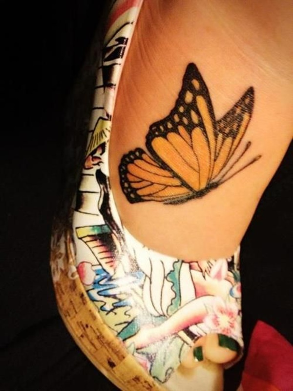 Flying Nice Monarch Butterfly Tattoo Design On Foot