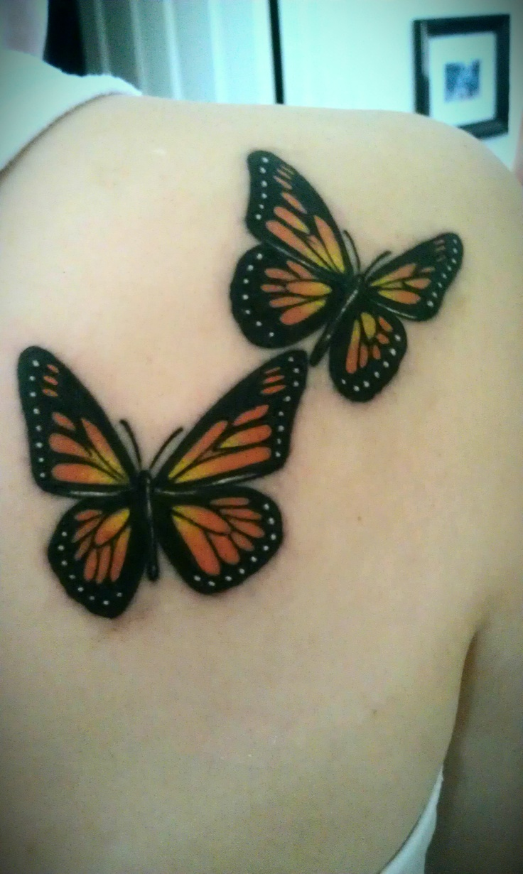 Flying Two Monarch Butterfly Tattoo On Upper Back