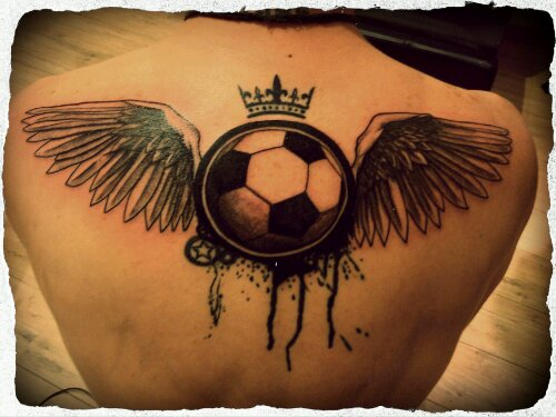 Football In Angel Wings Tattoo On Upper Back