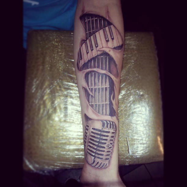Forearm Ripped Skin Ultimate Guitar Piano Keys Tattoo Design With Microphone