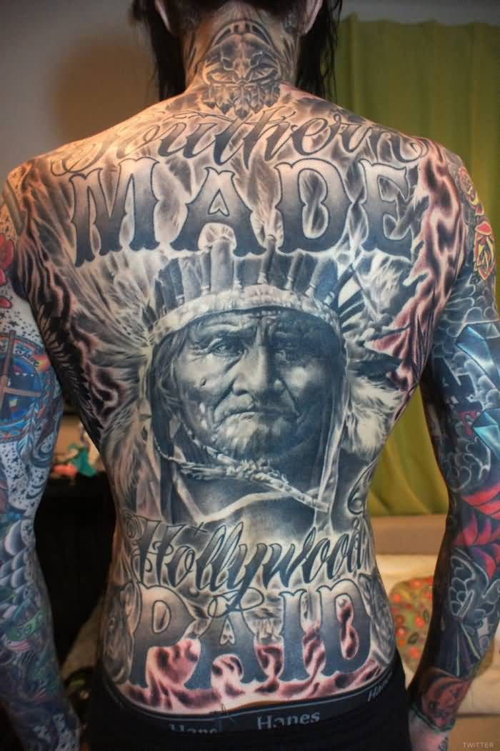 Full Back Latino Native Face And Letters Tattoo